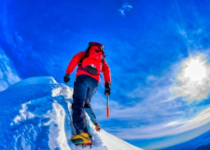 Man climbin a mountain photo