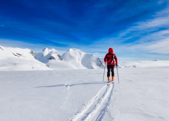 Man walking on the mountain snow